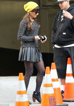 Snappy dresser: The Bronx-born starlet's character Rachel Berry appeared to have channelled an edgy New York style for her day of filming, rocking a charcoal grey knitted jumper with white fleck detailing and a flirty black leather pleated mini