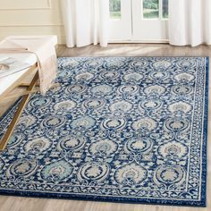 Make a bold statement in any room with the&nbspSafavieh Evoke Royal Blue and Ivory Rug. This beautiful rug features a traditional oriental pattern in vibrant blues and ivory. It will be an eye-catchin