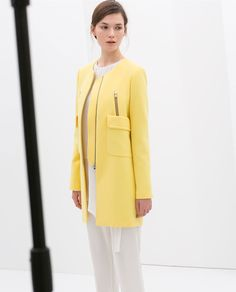 3.000,- Image 1 of COAT WITH POCKETS from Zara