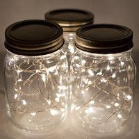 Use mini lights to spice up the backyard this summer! String lights in mason jars are perfect for lighting up a table.