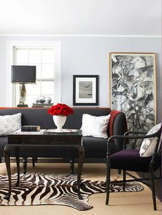 Mix and Match            Combining shades of gray is a subtle way to give any room character. These light gray walls balance the deeper tones of the furniture. Bright accents give this living room the right amount of contrast and visual play. A zebra rug adds a fun focal point.