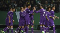 Real Madrid's players celebrate after Real Madrid's French defender Raphael Varane scored during the UEFA Champions League football match Sporting CP vs Real Madrid CF at the Jose Alvalade stadium in Lisbon on November 22, 2016.