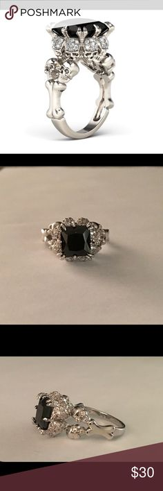 Men's black stone skull ring Black stone with surrounding skulls. Platinum platted with Genuine Cz . Accessories Jewelry