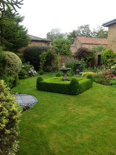 Framing an insignificant feature with topiary immediately gives it more importance.