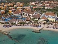 Gran Bahia Principe Akumal - this beach in front of the lobby and main pool area is the most calm and even offers mediocre snorkeling opportunities.  Be careful of the roped off out of bounds because it is a protection are and because of riptides.