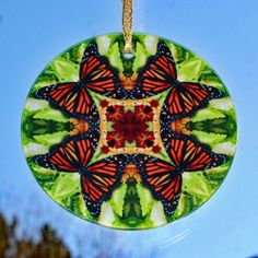 Glass suncatcher adorned with my monarch butterfly boho chic mandala new age sacred geometry kaleidoscope design tilted Free Spirit <br /> <br />This stunning butterfly glass suncatcher illuminates my geometric mandala kaleidoscope design when light shines through it! It is 3 - ½ inches in diameter and has a beveled edge. The suncatcher comes with a ribbon and%2...