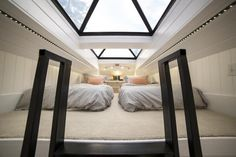 Built in Sandy, Utah, by Patrick Romero is this stunning tiny house with skylights and a covered front porch.