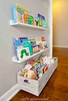 Simple ledge book shelves and stuffed animal bin at kid/rocking chair level.