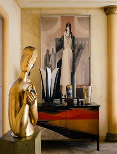 An art deco interior from Félix Marcilhac´s Paris apartment: Painting by Gustave Miklos Figures et Chien (1921), Jean Dunand cabinet (1921) and Ozzip Zadkine´s Jeune Fille á la Colombe (1928) gold plated statue. Photograph by Jerome Galland. / Jerome Galland