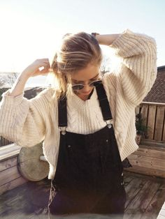 Overalls & cream sweater.