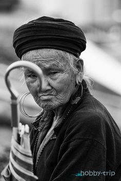 Portrait of a woman with umbrella by Mariyan Hristov on 500px
