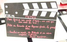 Au milieu de la table, voici un clap de cinéma sur lequel vous pourrez noter votre menu. N'hésitez pas à y inclure des jeux de mots et des références à vos films préférés !