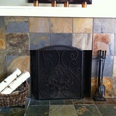 slate tile fireplace. Wonder if this would be more cost effective than full stone?