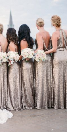 Jenny Yoo Bridesmaids, glittering Sequin Tulle Bridal Party in Rose Gold for a playful and glamorous look. The Sloane Dress has a high slim neck. The bodice is slightly bloused, flattering the midsection + complimenting the waist with an elegant keyhole in the high back.The Jules has a narrow A-line slip dress with spaghetti straps. A narrow fit throughout the hip creates a sleek look for an overall flattering silhouette. The floor length skirt gives a more formal appeal for a black tie…