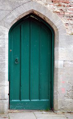 makes me think of a doorway in an old monastery. (without the green paint)