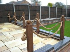 Some rope fencing decorating the edge of a patio. : Some rope fencing decorating the edge of a patio. Rope Fence, Rope Railing, Deck Railings, Garden Railings, Diy Fence, Flower Bed Edging, Garden Edging, Flower Beds, Border Garden