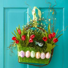 We love this festive Easter door decoration! Find out how to make it here: http://www.bhg.com/holidays/easter/decorating/easter-spring-door-decorations/?socsrc=bhgpin022613easterdoor