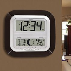 Amazon.com: La Crosse Technology WS-8418U-IT Atomic Digital Wall Clock with Moon Phase: 10-1/4 inches wide by 1-1/6 inches deep by 9-3/4 inches $39.98