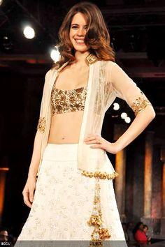 Kalki Koechlin showcases Manish Malhotra's creation during Shabana Azmi's charity fundraising fashion show 'Mijwan' at Grand Hyatt in Mumbai on September 3, 2012.