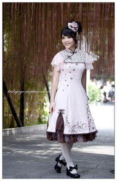 Taobao - Kidsyoyo.  Qi-loli embroidered dress.  Nylon fabric, all kinds of net yarn, chiffon; cotton lining, hand-plate buttons.  748 Yuan / $118.72.