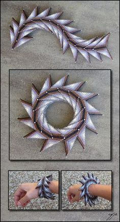 """(2016), 9""""x1.5"""", Size 11 Delica beads (dark raspberry metallic DB0004, white-lined dark mauve DB1790, white-lined amethyst DB1789, light grey ab DB1508, white ab DB1500) worked in a combination of ..."""