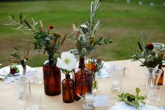 flowers in amber bottles; Bottle Centerpieces, Wedding Centerpieces, Wedding Table, Fall Wedding, Wedding Decorations, Table Decorations, Wedding Ideas, Centrepieces, Decor Wedding