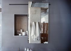 The door to Hill's medicine cabinet, made by George Sacaris, slides open to reveal a concrete wall. Bathroom Solutions: Smart Storage Design by Diana Budds from Stripped Ease. Browse inspirational photos of modern homes. Industrial Apartment, Industrial Interiors, Industrial Bathroom, Smart Storage, Hidden Storage, Storage Design, Storage Ideas, Modern Bathroom Design, Modern Design