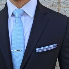 Effortless style with a pin dot tie and gingham blue pocket square.