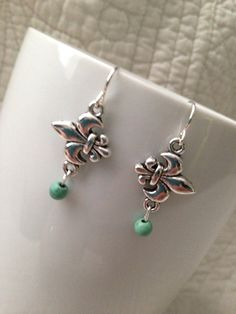 Sideways Fleur De Lis Silver and Green Turquoise Earrings. on Etsy, $13.50
