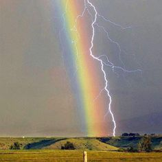 Lightening and a rainbow connected. Amazing sight!