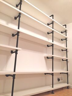 White Painted Pine and Textured Matt Black Powder Coated Steel Pipe Bookcase - Its perfectly finished industrial design works perfectly in sophisticated, casual living spaces.  This shelving system can be made to measure to your own specifications. The shelves pictured here are 2950mm wide x 300mm deep x 2250mm high... but the skys the limit... these shelves could easily be freestanding... to make them freestanding we would simply replace the top section with horizontal pipes running between…