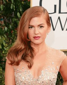 Isla Fisher has beautiful copper red hair.  We do all shades of red to match your skin tone.