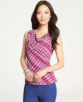 "Marina Print Shirred Cuff Peplum Shell - A color-splashed print saturated in rich poolside hues says ""getaway chic"" to us. Cowl neck. Sleeveless with shirred cuffs. Front and back peplum."