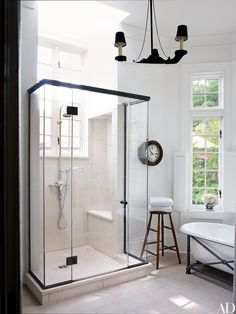 In this home near Washington, D.C., by designer Darryl Carter, a bathroom features a vintage tub and separate standing shower. | archdigest.com