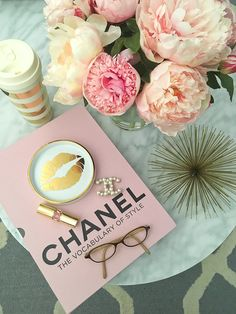 StylishPetite.com | Chanel pearl brooch, Chanel The vocabulary of style book, faux silk peonies in glass vase, Gold urchin, Grey trellis tufted rug, Kate Spade gold striped thermal mug, Oval marble coffee table, Rosanna Gold Trim Porcelain Wine Coaster, YSL lipstick - click the photo for details on each item!