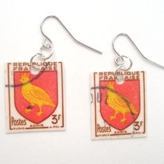 truebluemeandyou:  DIY Postage Stamp Earrings Tutorial from Think Crafts! here.They suggest using a laminating machine (expensive) or Mod Podge. I'd personally use self adhesive laminating sheets which you can buy in huge packs and the last forever like these from Amazon here (no affiliate link). These are the sheets I've used to laminate book marks, IDs etc…