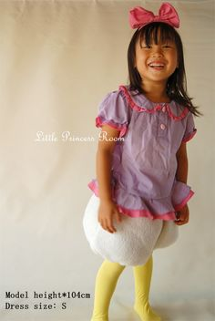 Inspiration for making a Daisy Duck costume this Halloween.