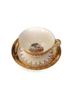 Truly elegant vintage tea cup and saucer with warranted 22 karat gold. This is the Eggshell Nautilus Pattern from Homer Laughlin China. This