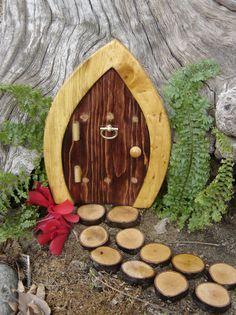 """Fairy Door, Gnome Door, Hobbit Door, Elf Door, Troll Door, Miniature Garden Fae Door, 7"""" tall Enchanted style.. $14.95, via Etsy."""