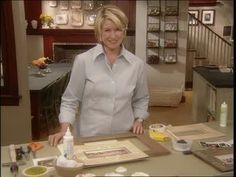 Martha Stewart makes a sand mat for a picture frame with glue, natural play sand, and shells.