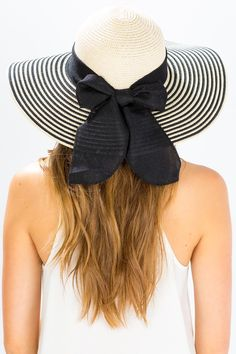 A breathtakingly romantic floppy hat, featuring a jaunty striped brim and wide linen ribbon with large bow accent at back. Stitched sweatband inside. Domed crown. $15.90