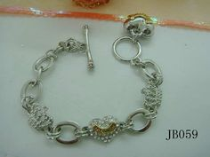 Juicy Couture Bracelet With Peach Heart Pendant In Silver half-off   $23.00