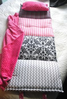 "Janiebee Hollywood Quilted Nap Mat. ""The ultimate in luxury nap mats, Janie Bee's mats are made with luxurious cottons, Minky brand Dimple blankets and TWO inches of thick, soft, quilter's batting. It even includes pillowcase and blanket attached at the side. Use for preschool, sleepovers, or visits to Grandma's! This version is perfect for any girly girl with its trendy pink, white, and black patterns. Also can be personalized."" -Joanna Dreifus from My Mom Shops"