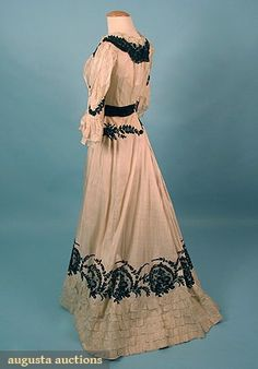 """SUMMER TEA GOWN, c. 1905 2-piece China silk trimmed w/ embroidered black lace appliques, Sh-Sh 13"""", B 32.5"""", W 23"""", Front Skirt L 41"""", Back Skirt L 47"""", (bodice w/ faint stains & damaged black waistband), skirt excellent."""