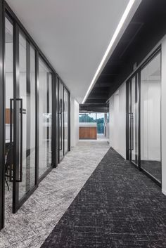 American Petroleum Institute Offices - Houston - Office Snapshots Office Ceiling Design, Office Interior Design, Office Carpet, Office Floor, Corporate Interiors, Office Interiors, Hallway Office, Corridor Lighting, Commercial Office Design