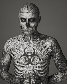 holy tattoos! But pretty cool... Halloween costume makeup? :)