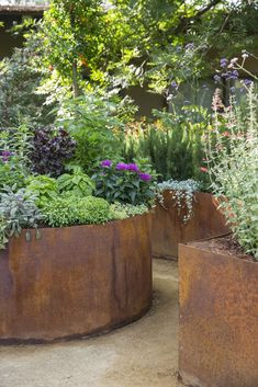 planters look so beautiful in this modern cottage garden design., Corten planters look so beautiful in this modern cottage garden design., Corten planters look so beautiful in this modern cottage garden design. Patio Garden, Garden Design, Plants, Corten Steel Planters, Garden Planters, Small Gardens, Cottage Garden Design, Modern Garden, Garden Pots