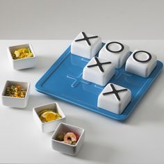 Tris includes 1 tray and 9 ceramic bowls. It's ideal ad hors d'oeuvre dish, but also as a collector of small objects in the office or home. The 9 containers, once inverted and put it on the tray, transform tris onto the homonymous pastime to play with and entertain friends. available only on http://www.bosatrade.com/en/Products#filter=*