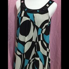 Tea length dress Dress is colored with black, white and blue running throughout. Same color jewels lining collar. Dress has movement and swing to it. Only worn a few times and is in perfect condition. Dress Barn Collection Dresses