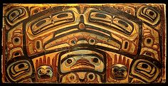 A large bentwood storage chest. The front of the chest portrays the face of Konankada, Chief of the Undersea World. The bas-relief sculpture and incised formlines of the ovoids and eyes represent the highest level of surface decoration achieved by Haida artists. Collected on Haida Gwaii in 1898 by W. A. Newcombe. CMC VII-B-129.3 (S92-4193)